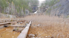 Rails in water quarry. Urals, Russia. 4K Stock Footage