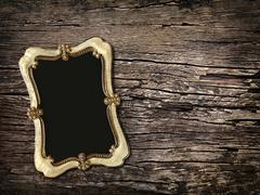 Old vintage photos on a wooden background Stock Photos