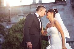 Beautiful bride and groom celebrating their wedding day in the city - stock photo