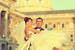 Stock Photo of Beautiful bride and groom celebrating their wedding day in the city
