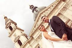 Beautiful bride and groom celebrating their wedding day in the city Stock Photos