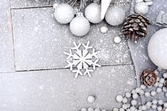 Stock Photo of Snowy Christmas Background with a Snowflake
