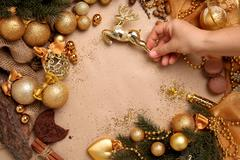 Stock Photo of Christmas Background in Gold Tones with a deer