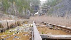 Rails in water quarry. Urals, Russia. 4K Stock Footage