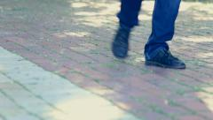 Man walking in city. Close up of legs. Old black male shoes. - stock footage