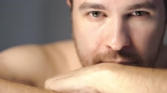 Young man with short beard and folded hands looking and smiling in the camera Stock Footage