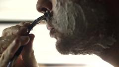 Man shaving his foamed face, close up video Stock Footage