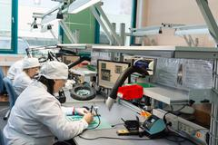Production of electronic components  at high-tech factory Stock Photos