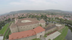 Aerial view of Fagaras Fotress with brick walls and the other old buildings - stock footage