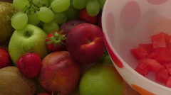 Fruit salad in a bowl with strawberries, kiwi, peach and melon Stock Footage