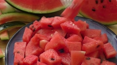 Fresh water melon pieces in blue bowl Stock Footage