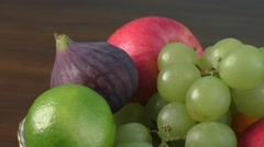 Assortment fruits on wooden table Stock Footage