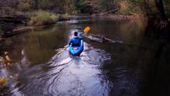 Man kayaking on the forest river Stock Footage