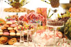 Delicious sweets at wedding candy bar - stock photo
