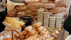 Open air food market. Stall with smoked cheese, lard and bread Stock Footage