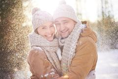 Laughing in snowfall - stock photo