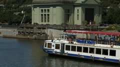 Stock Video Footage of Albatros riverboat floating next to Štvanice Island, Prague