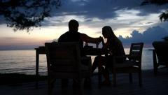 Young couple dining exclusively romantic atmosphere island just after sunset Stock Footage