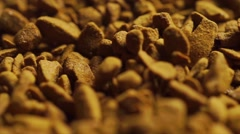 Macro dolly shot of instant coffee granules - stock footage