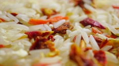 Rotating heap of uncooked rice and vegetables. Macro video Stock Footage
