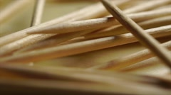 Pile of wooden toothpicks macro dolly shot Stock Footage