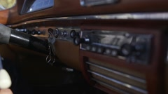 Dashboard of an old convertible Oldsmobile Stock Footage