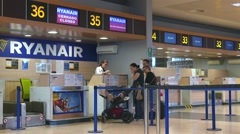 Passengers at a Ryanair check-in counter at the Valencia airport. Stock Footage