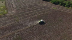 Harvester Collects Sunflowers. Aerial Survey - stock footage