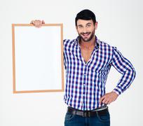 Stock Photo of Happy man holding blank board