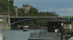Small boat floating under Stefanik Bridge in Prague Stock Footage