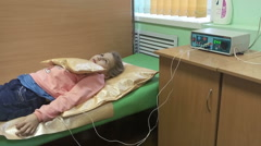 Stock Video Footage of Preschool girl a little patien has chest warming procedure with electrophoresis