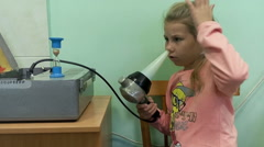 Little girl doing medical procedure for nose rhinitis cure with UV radiation Stock Footage