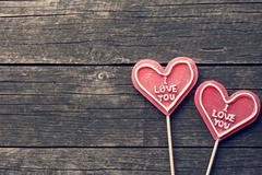 Lollipop heart on vintage wooden background Stock Photos