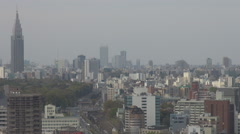 Aerial view traffic infrastructure train railway busy avenue Tokyo downtown day Stock Footage