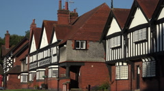 Stock Video Footage of Slow zoom in to Arts and Crafts Houses in Port Sunlight, Wirral, England