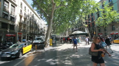 Tourists on Ramblas in Barcelona Stock Footage