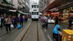Tram move towards on market street full of people, POV walk shot - stock footage