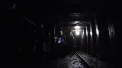 Shot in dark coal mine in glace bay with tourists families Stock Footage