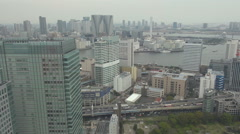 Aerial view Tokyo skyline suburban area traffic car busy freeway asian building  Stock Footage
