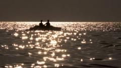 4k Beautiful seascape sunset with pedal boat silhouette Stock Footage