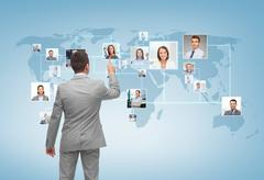 Businessman pointing finger to contact icons Stock Photos