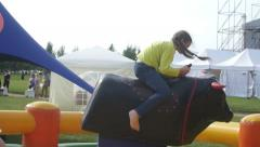 Riding a mechanical bull. Slow motion Stock Footage