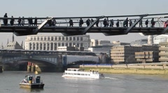 LONDON, UK - FEBRUARY 19, 2013: Commuters cross Millennium Bridge - stock footage