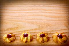 Shortbread cookies with jam isolated on wood background. Stock Photos