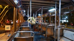 Traditional double decker tram interior, night time, Victoria Park tramway stop Stock Footage