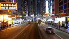 Neon chinese signboards over night city road, rear view from moving vehicle Stock Footage