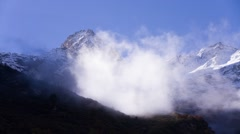 Alpine mountian in the clouds Stock Footage