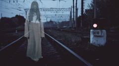 Horror scene of a scary woman - the bugle on railway track Stock Footage
