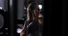 Attractive female punching a bag with boxing gloves on. Shot on RED Epic. Stock Footage