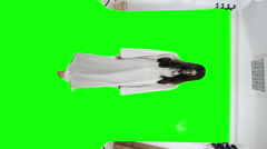 The girl - a demon close to the camera. Shooting on the Chroma key - stock footage